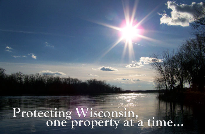 photo of a lake with the text Protecting Wisconsin, one property at a time... laid on top of the image